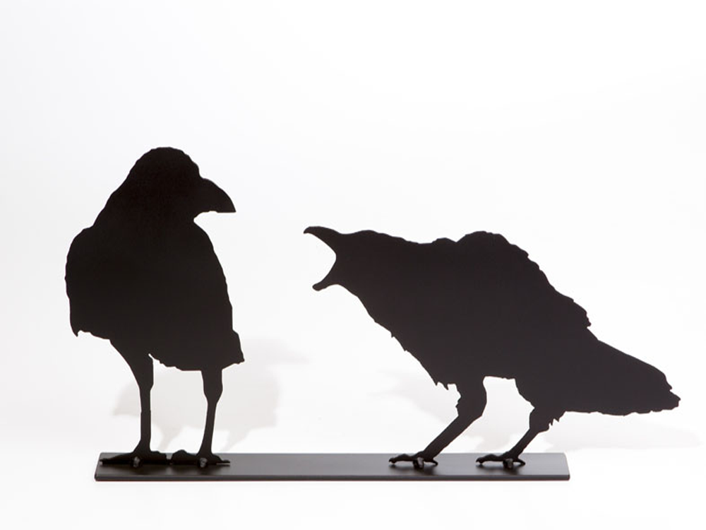The matte black silhouette of two crows standing together. The right crow is cawing at the left crow. The right crow has a jagged outline which creates a realistic impression of ruffled feathers. The left crow seems unfazed by it crying counterpart.
