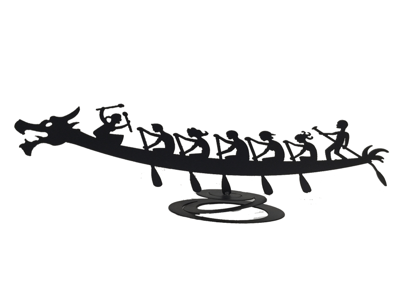 This metal sculpture shows the matte black silhouette of a dragon boat piloted by seven figures. The boat and the six rowers face left. The first five rowers are seated with their oars in the water. The sixth rower stands at the back of the boat and steers using a long thin oar. The seventh figure is the drummer, who sits at the front of the boat facing the rowers. The piece sits on a metal spiral which allows the boat to sway in place.