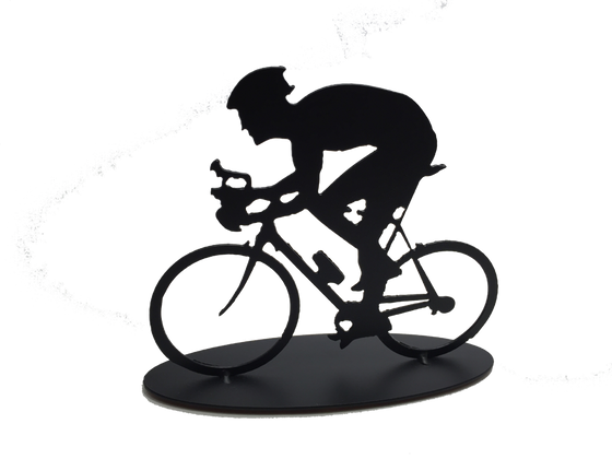 This metal sculpture shows the matte black silhouette a male cyclist hunched forward over their handle bars. He faces left and stares forward intently. The bike design is slightly simplified, and the wheels have no spokes. The piece stands on an oval base.