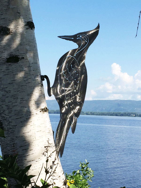 The mountable woodpecker in a brushed metal finish. This picture provides a clearer view of carved details of the woodpecker's wings and tail feathers.