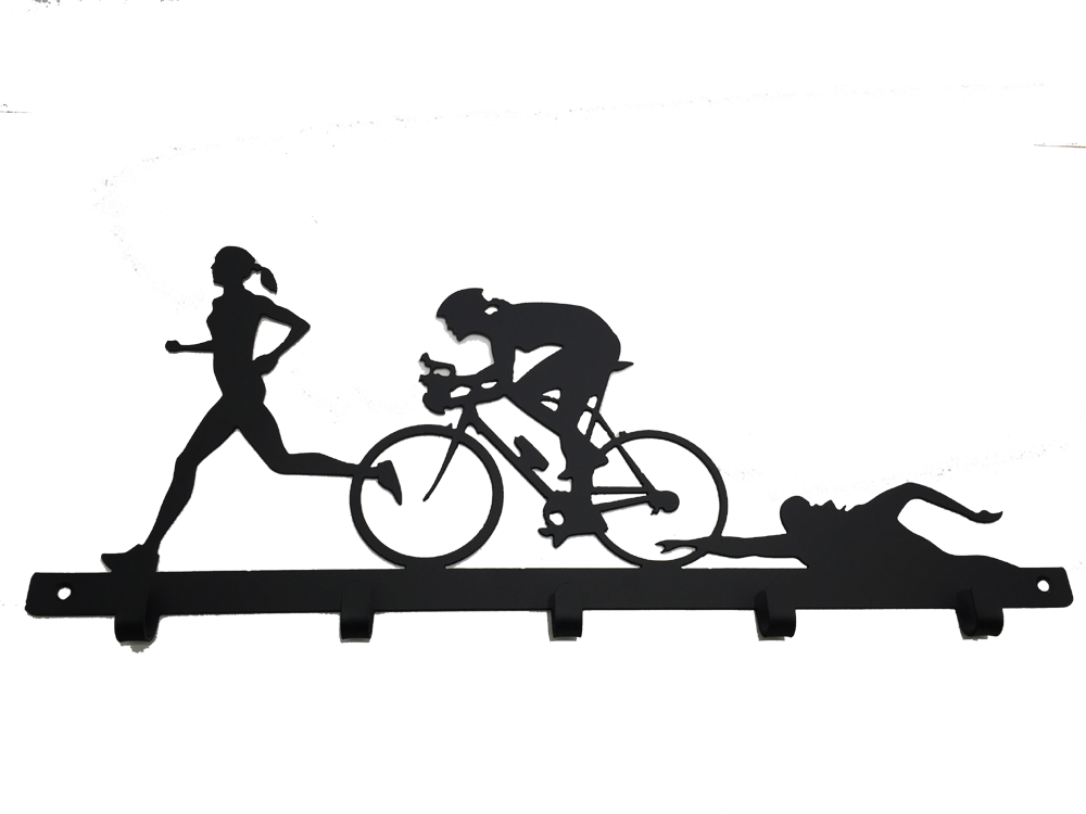 This metal sculpture shows the matte black silhouette of three female figures, each doing one trial in a triathlon. The leftmost is running, the center is biking, and the rightmost is swimming. The silhouettes slightly overlap each other. At the base of the sculpture is a metal strip form which five metal hooks emerge. The strip has two holes punched through it, allowing the piece to be nailed or screwed into a wall.
