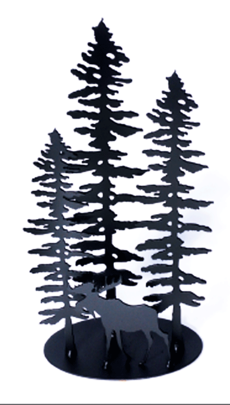 A metal sculpture showing the matte black silhouettes of three staggered Sitka pines and a moose. The moose stands in front of the trees, facing left. It has a full set of antlers and a pronounced dewlap. The trees are tall but slim. Their short, broad branches are about the same length along the whole tree, except at the top where they form a point. The sculpture sits on an oval base.
