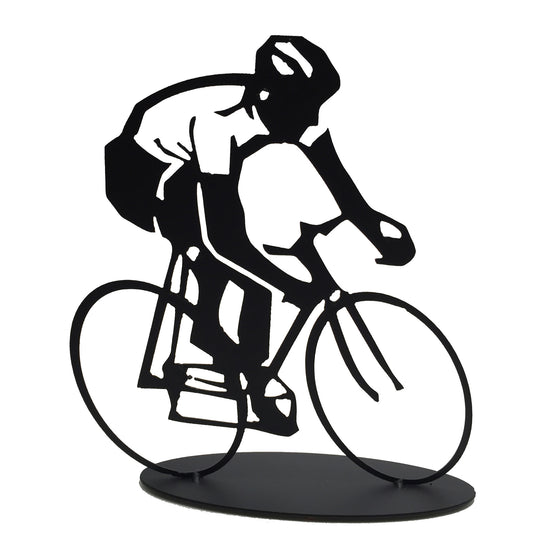 This metal sculpture shows the matte black silhouette of a cyclist riding a bike. The cyclist's shirt has been cleverly made by punching out the metal, allowing the background to shine through. The piece is carved on a slightly slanted perspective, giving the impression that the cyclist is moving very quickly or beginning a turn. The piece sits on an oval base.