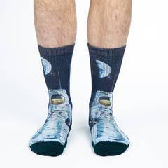 These fun socks feature a photo of an Apollo astronaut standing on the moon with the earth behind him, half lit by the sun, and stars beyond that. The sole, toe, heel, and rim of the sock is black. The active fit socks sport elastic arch bands to contour to your feet and provide support.