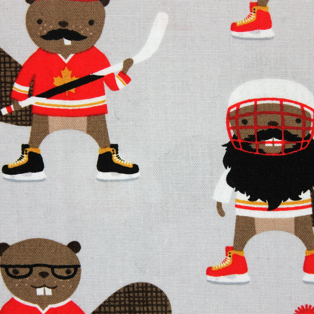 Grey face mask with cartoon beavers wearing hockey gear.