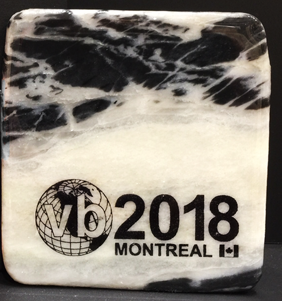 This coaster is made of a piece of canadian shield marble with mineral lines running through in unique colours, lines, and patterns. A logo of your design is put onto it. The coaster is finished with a clear coat, giving it a shiny finish.