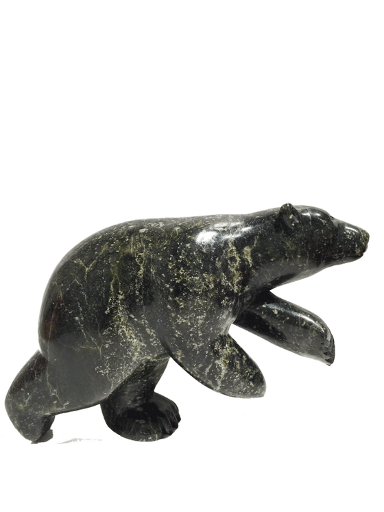 A soapstone carving of a dancing bear by Pudlat Shaa. The bear is standing on it's hind legs, which gives the illusion that the bear is indeed dancing. This piece is made from a dark black stone with  yellow marbled patterning throughout. In this photograph, a side view of the bear is shown.