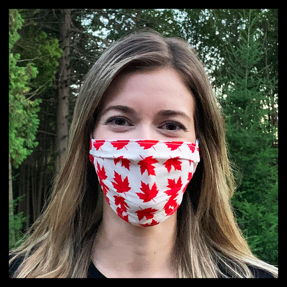 White face mask featuring red maple leaves. Two elastic earbands are included for easy wearability.