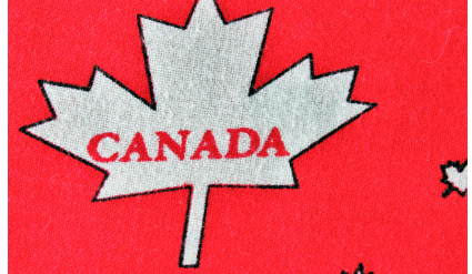 "Red canadian made face mask featuring white maple leaves and ""CANADA"""
