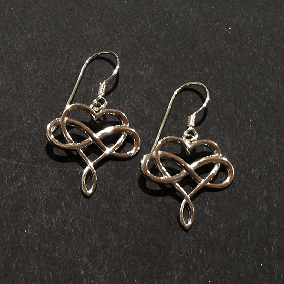 Two hook earring featuring a sterling silver infinity symbol intertwined with a heart. The infinity symbol crosses the middle of the heart horizontally. The bottom of the heart twists to form a loop reminiscent of the infinity symbol.