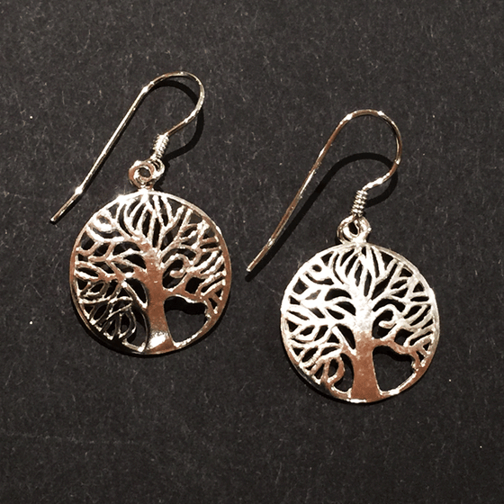 Two sterling silver tree earrings sit on a black background. The trees are contained within hoops. The trees' numerous thin branches radiate outward and fuse with the outer hoops. A silver earring hook attaches to the top of each hoop.