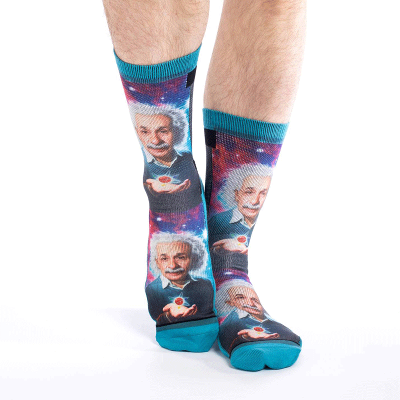 These fun socks feature a picture of Albert Einstein with an atom in the palm of his hand, and a galaxy behind him. The sole, toe, heel, and rim of the socks are blue. The active fit socks sport elastic arch bands to contour to your feet and provide support.