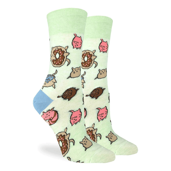 These adorable socks feature cats as different types of donuts on a light pastel green background and a light blue heel. Spandex added to the 85% cotton blend gives the socks the perfect amount of stretch to hug your feet.