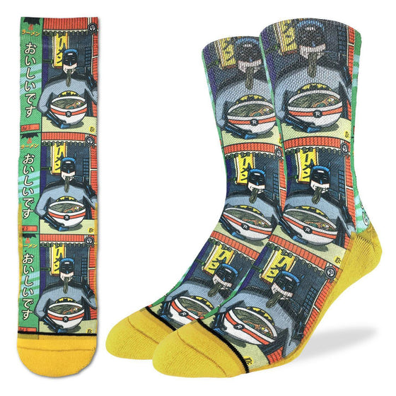 These fun socks feature a 1980's comic book version of Batman sitting at a chinese noodle shop eating a bowl of ramen noodles. The image is printed three times, and the sole, toe, and heel of the socks are yellow. The active fit socks sport elastic arch bands to contour to your feet and provide support.