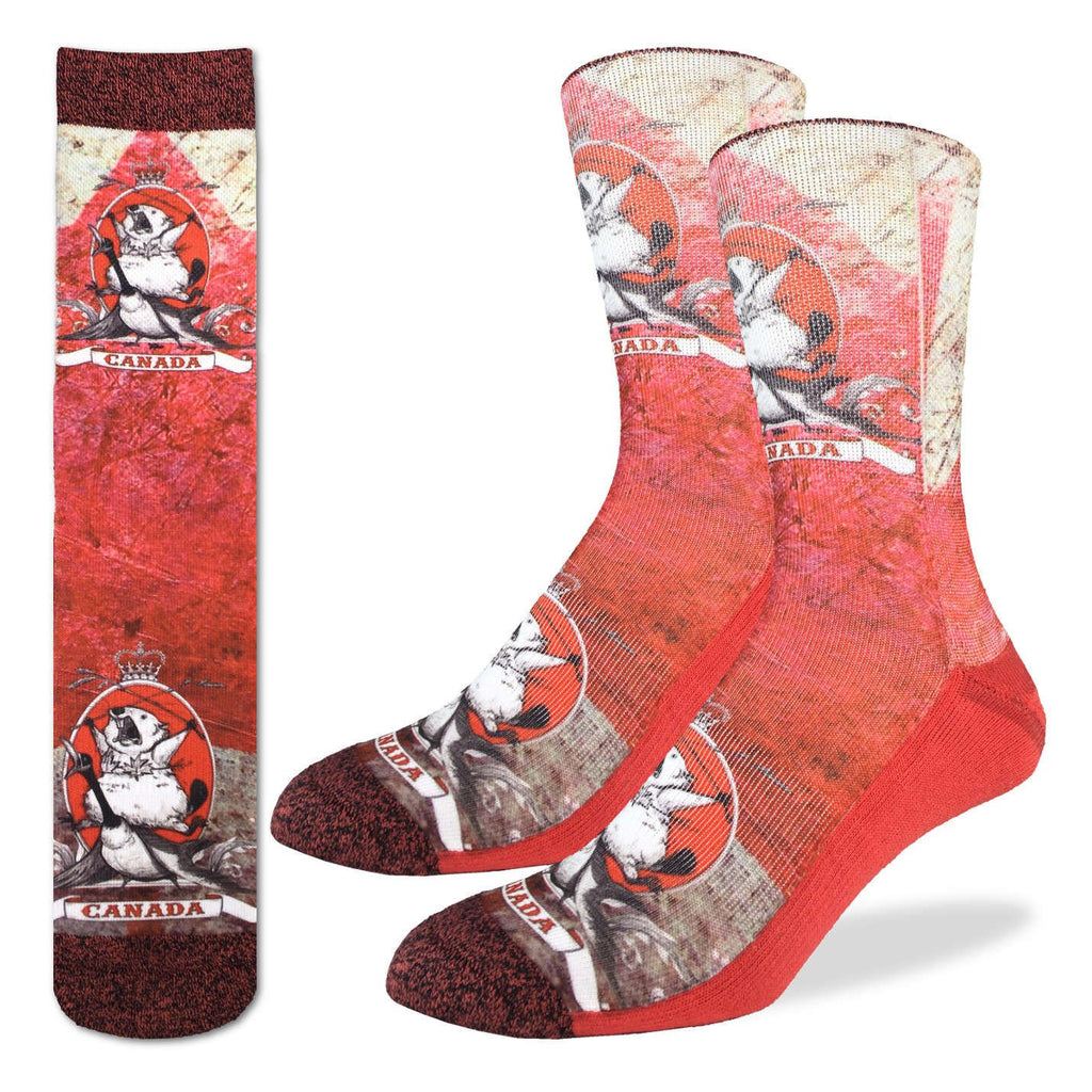 These fun socks feature the black and white image of a beaver yelling while holding two wheat stalks above his head and wearing maple leaves as a bikini top while riding on the back of a goose. Canada is written on a ribbon underneath the beaver, while a picture of the Crown Jewels of the United Kingdom sits above the beavers head. The toe and rim of the socks are a speckled dark red while the rest of the sock is red and white.