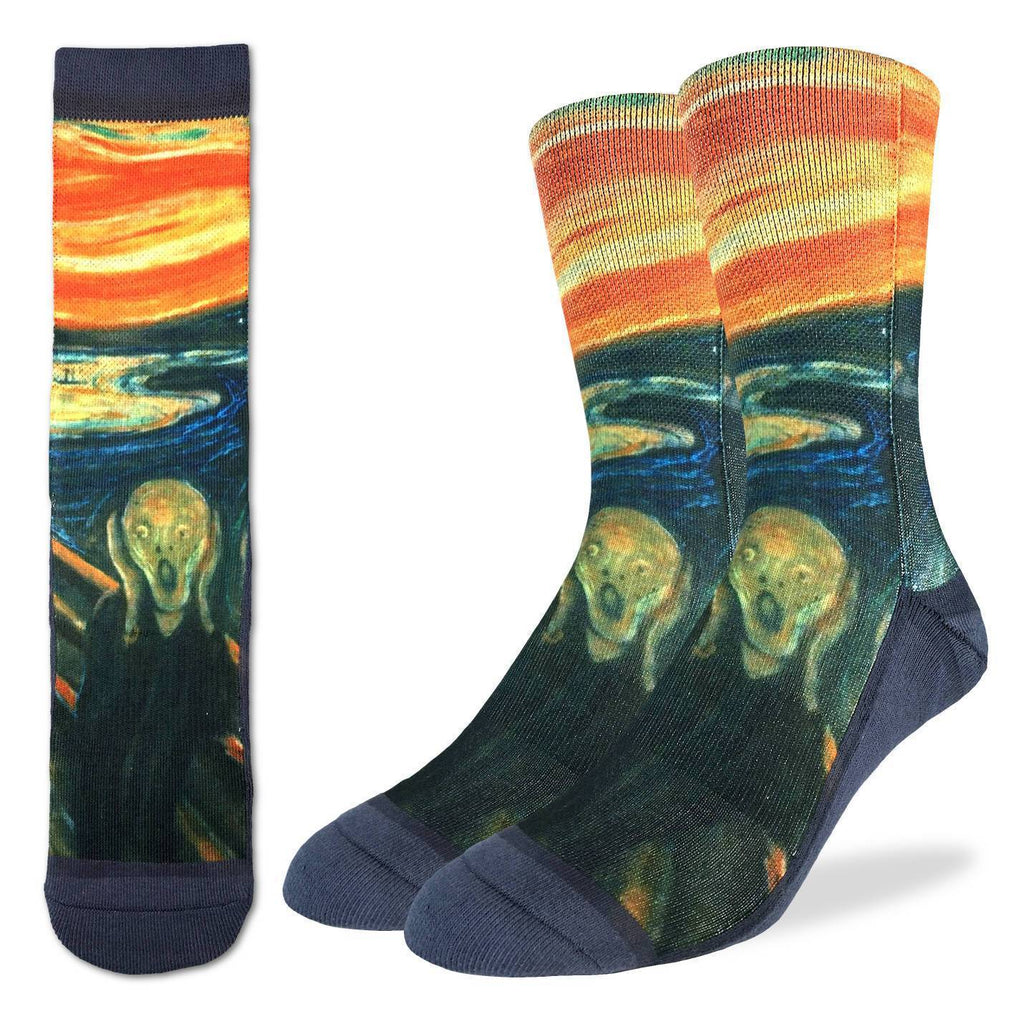 "These fun socks feature a print of the famous painting ""The Scream"" by Edvard Munch in 1893. The sole, toe, and heel of the socks are a deep navy blue. The active fit socks sport elastic arch bands to contour to your feet and provide support."