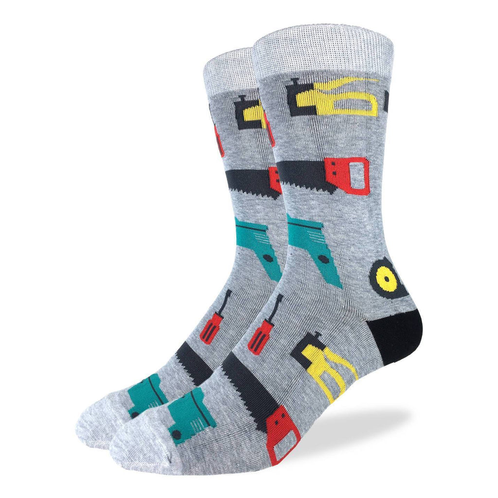 These fun socks feature hand tools such as a hand saw, staple gun, screw driver, cordless drill, pliers, a measuring tape, and a paint roller, on a grey speckled background with lighter grey toe and rim, and black heel. Spandex added to the 85% cotton blend gives the socks the perfect amount of stretch to hug your feet.