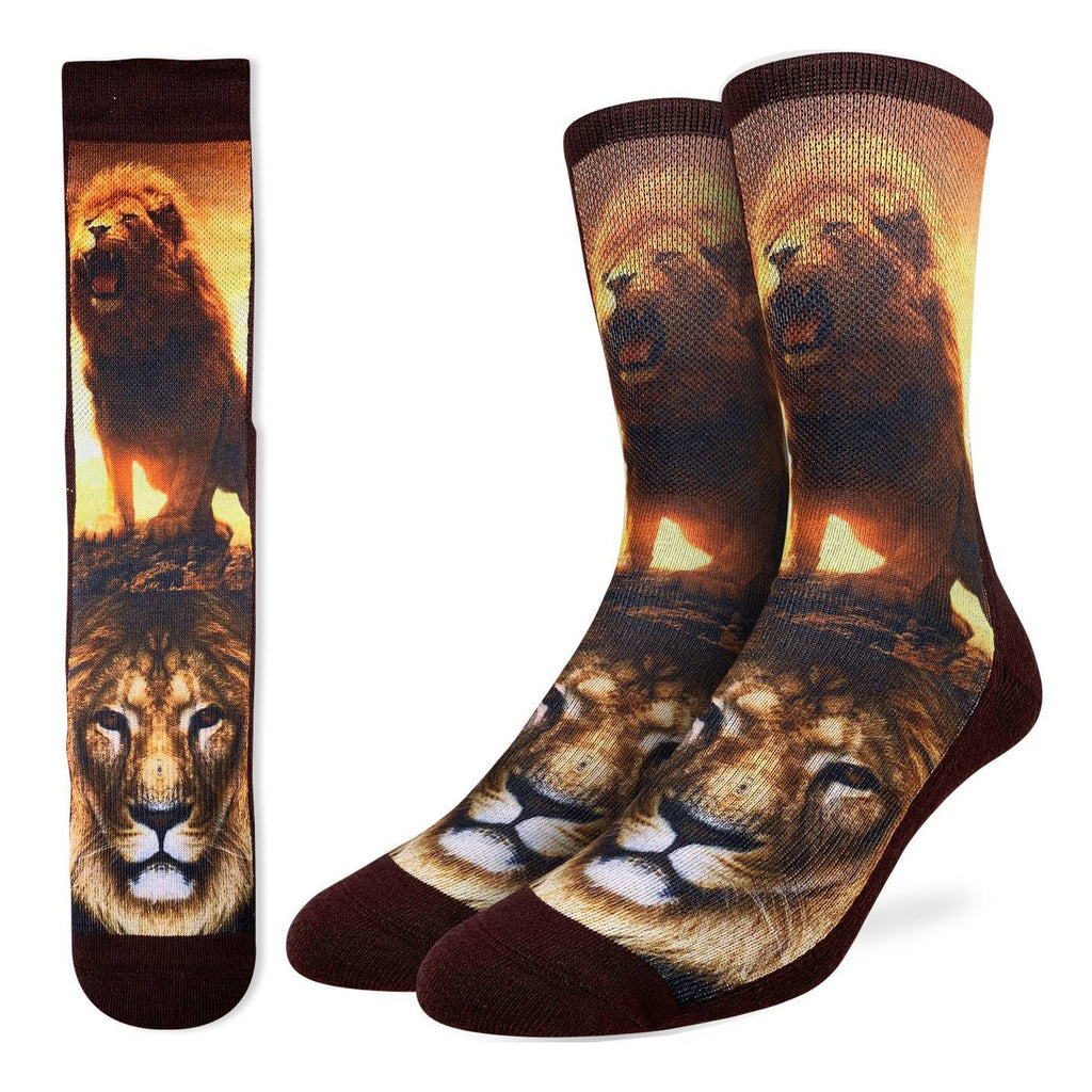 These fun socks feature the close up of an african lion, and a full body shot of a lion roaring with a beautiful orange sunset behind. The sole, heel, toe, rim, and back of the sock are brown. The active fit socks sport elastic arch bands to contour to your feet and provide support.
