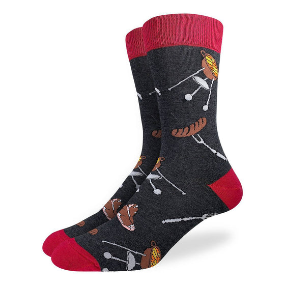 These fun socks feature the images of a charcoal grill, a steak, and a sausage on a fork repeated over the ashy grey background and red toe, heel, and rim. Spandex added to the 85% cotton blend gives the socks the perfect amount of stretch to hug your feet.