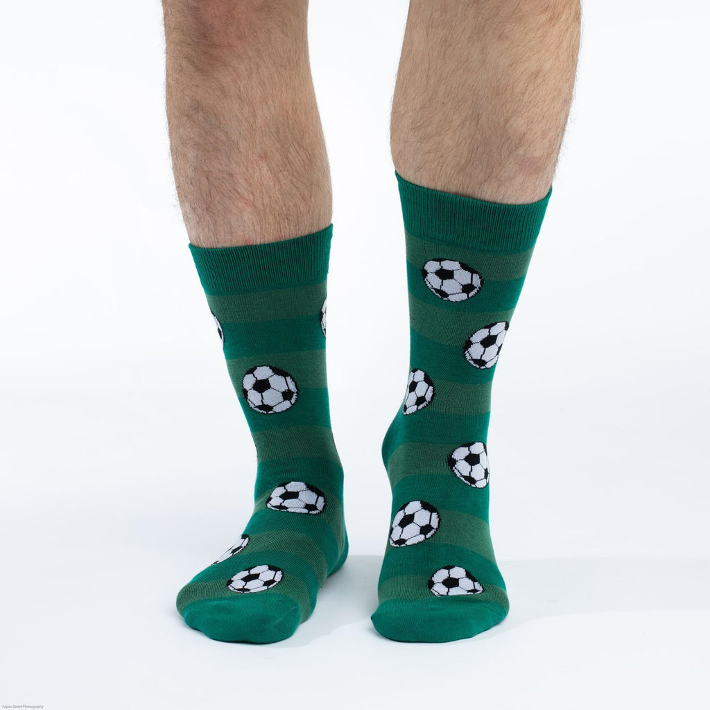 These fun socks feature soccer balls on a background imitating the light and dark green stripes of a soccer field. Spandex added to the 85% cotton blend gives the socks the perfect amount of stretch to hug your feet.