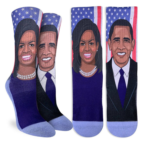 These fun socks feature cartoon images of Michelle and Barack Obama, one on each sock, with the American flag behind them. The sole, toe, and heel of the socks are a light blue. The active fit socks sport elastic arch bands to contour to your feet and provide support.