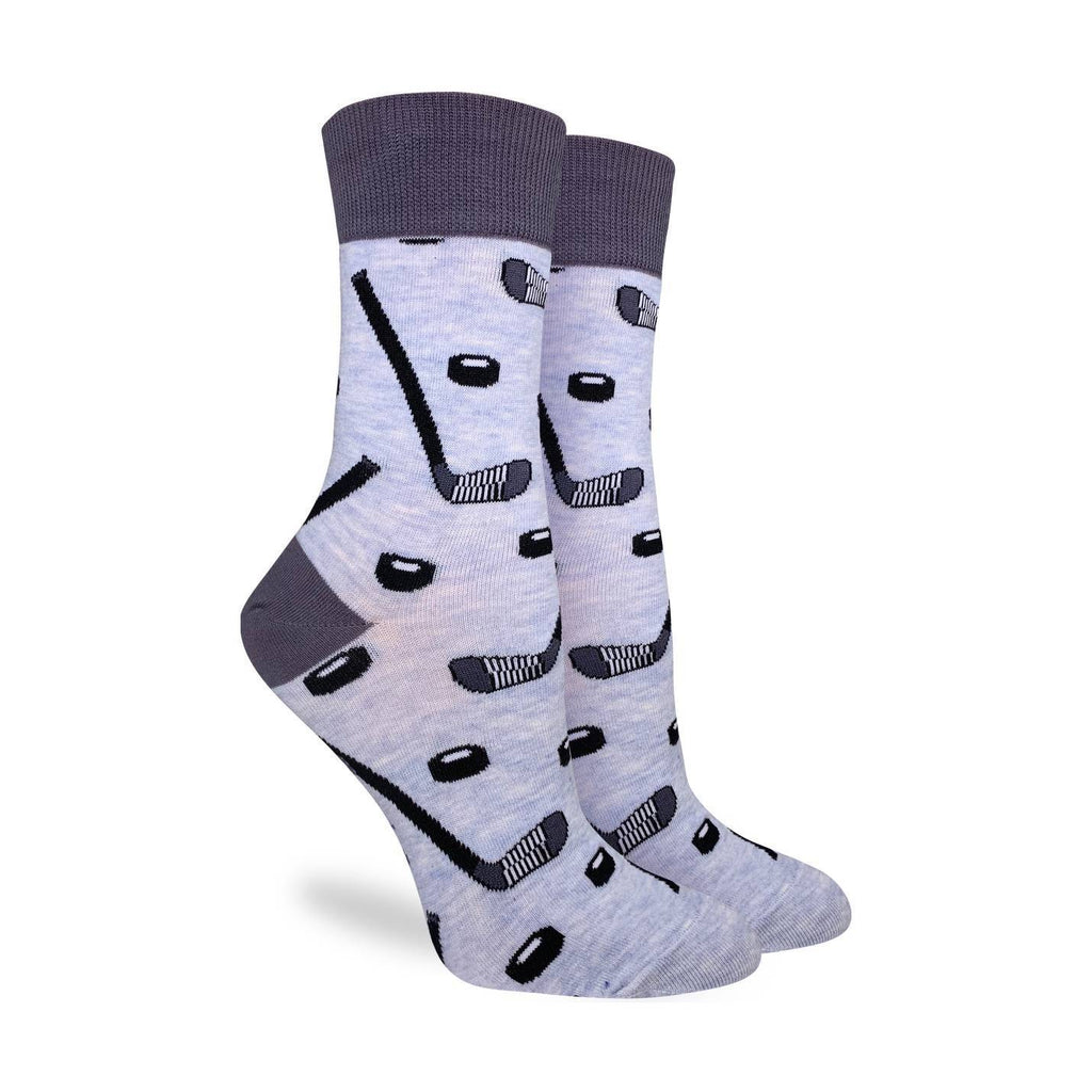 These fun socks feature black and white hockey sticks and pucks on a light grey background with a darker grey heel and rim. Spandex added to the 85% cotton blend gives the socks the perfect amount of stretch to hug your feet.