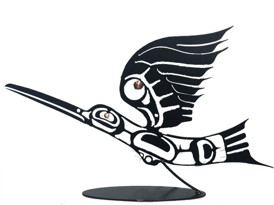 This metal sculpture shows the matte black silhouette of a hummingbird drawn in Coastal Salish style. The hummingbird is midflight, with its back arched slight downward and it wing stretched high above its head. Its long beak is two thirds the length of its body. A small copper disk marks the eye of the bird, and a slightly larger disk provides detail to the wing. A small angled rod connects the base of the bird to its oval base.