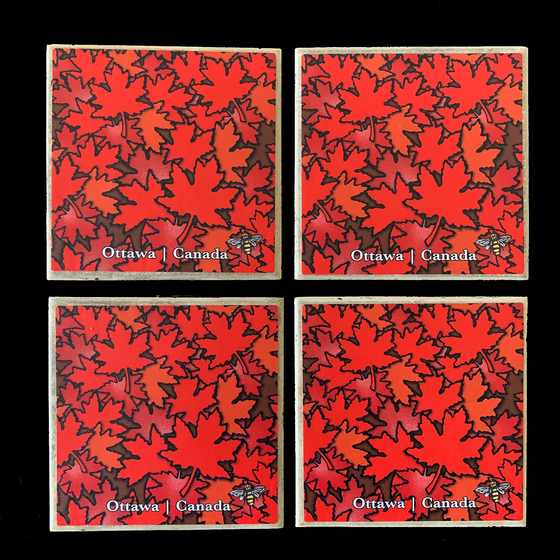 "This set of four ceramic coasters features an art print of maples leaves in several shades of red. The leaves are layered on top of each other and fill the coaster from corner to corner. At the bottom of the coaster the words ""Ottawa Canada"" are written in white text. At the bottom right is the artist's mark—a small picture of a bee."