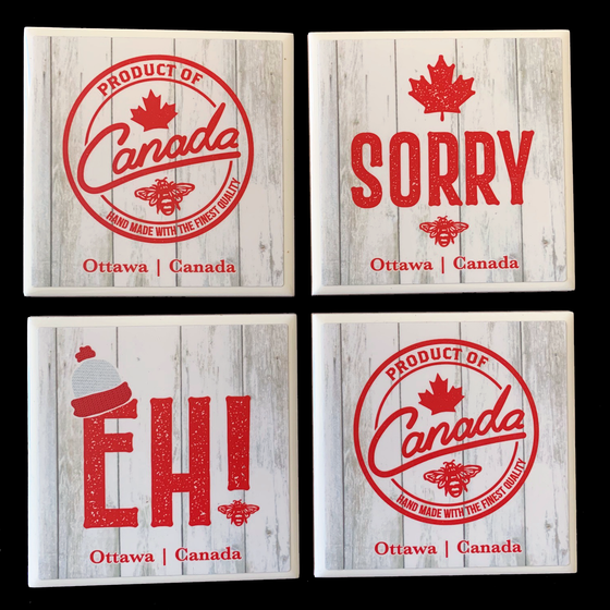 "This set of four ceramic coasters features three Canadian sayings printed in red on a grey background. One coaster says ""sorry"" and has a red maple leaf printed above it. One coaster says ""Eh!"" It has a small toque printed on it. The last two coasters say ""product of Canada, handmade with the finest quality"". The words are enclosed by a red ring which makes them look like a stamp or logo. At the bottom of the coasters the words ""Ottawa Canada"" are written in red text."