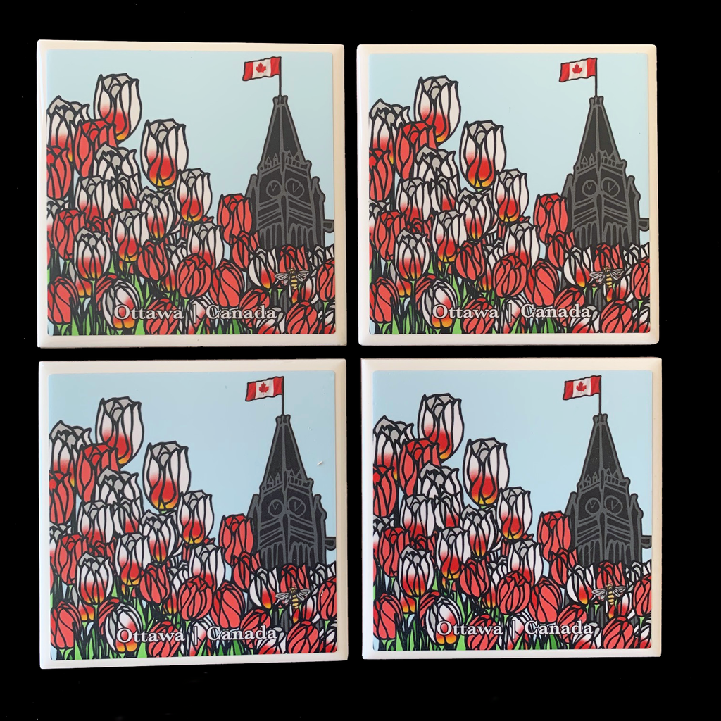 "This set of four ceramic coasters features an art print of the peace tower and a field of tulips. The tower is to the right of the picture and is flying the Canadian flag. Across the left and bottom are red tulips and Canada 150 tulips, which are white with fiery streaks of red .At the bottom of the coaster the words ""Ottawa Canada"" are written in white text. At the bottom right is the artist's mark—a small picture of a bee."