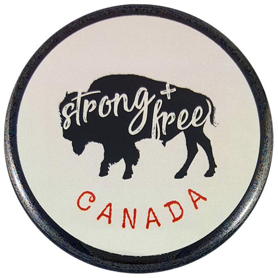 "This round magnet shows the black silhouette of a bison on a white background. The words ""strong and free"" are written across the silhouette in white cursive. The word ""Canada"" is written below the bison in red text."