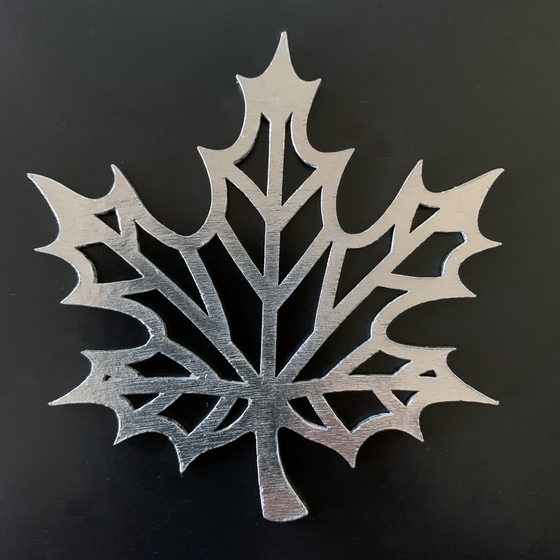 A maple leaf with lines where the leaf veins are, and hollow between the lines.