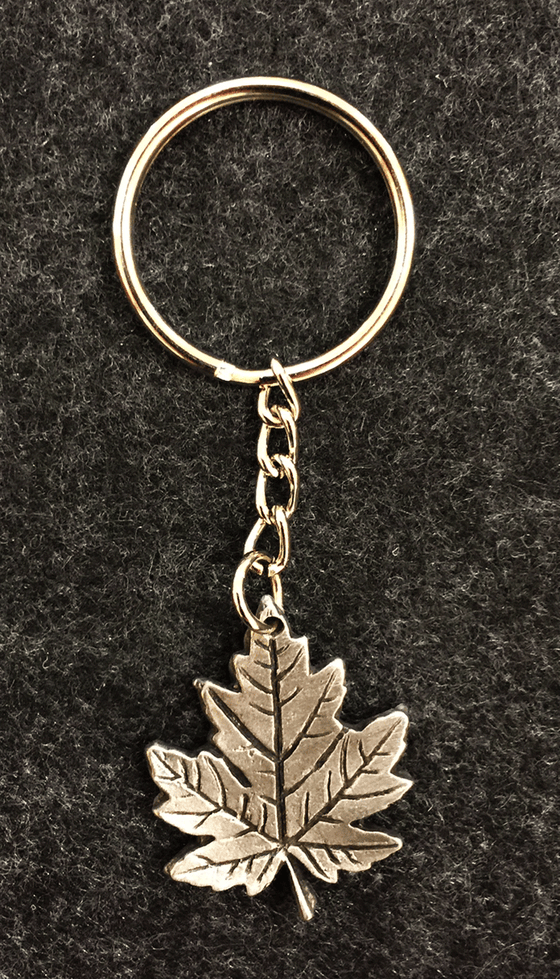 Pewter maple leaf attached to a small chain and a key ring