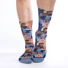 "These fun socks feature Neil Degrasse Tyson in a space suit in his ""We Need You"" poster. The sole, toe, and heel of the socks are a blue-grey. The active fit socks sport elastic arch bands to contour to your feet and provide support."