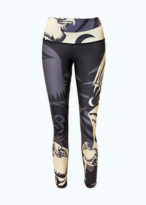 These black, grey and gold leggings are decorated with a stylized eagle motif repeated in several places across the leggings. The eagle has an intense stare and hooked beak. One gold eagle encircles the waist. There is a large grey eagle on the right leg whose wings extend around the entire leggings. Two more gold eagles stretch their wings up the left and right legs.