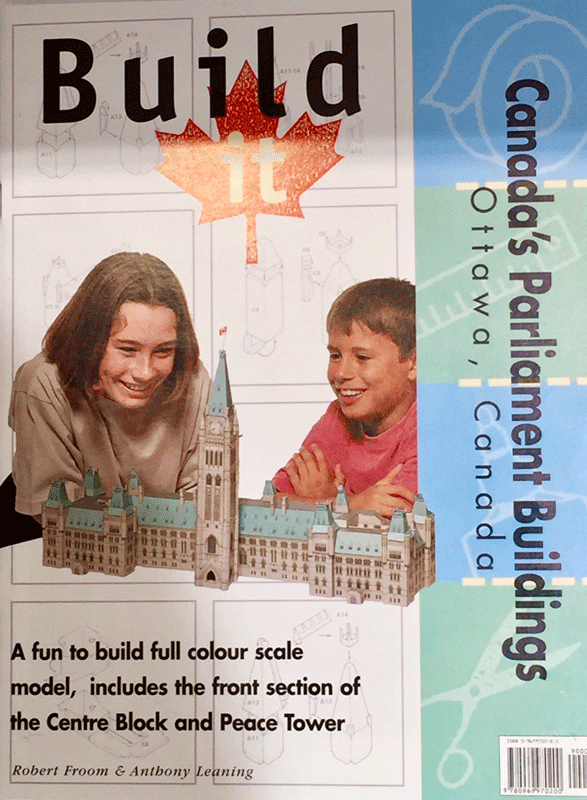 "The front of product's packaging, which shows two boys smiling at a completed model of Parliament. The packaging reads ""Build it, Canada's Parliament Buildings, Ottawa, Canada. A fun to build full colour scale model, includes the front section of Center block and the Peace Tower."""