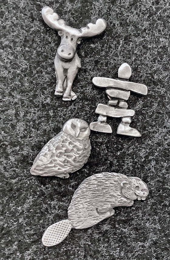 This set of four magnets includes a moose, beaver, owl, and an inukshuk.