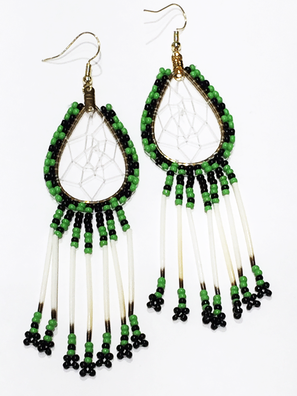 A pair of porcupine quill earrings. The hanging earrings are a tear drop shape hoop with dream catcher style weaving on the inside. Green and black beads are woven along the outside of the hoop and hanging off of the bottom are seven strands with green and black beads, then a piece of porcupine quill, with more green and black beads at the end.