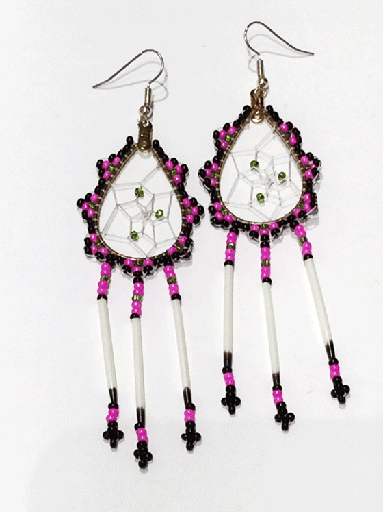 A pair of porcupine quill earrings. The hanging earrings are a tear drop shape hoop with dream catcher style weaving on the inside with green beads woven into it. Black, pink, and green beads are woven along the outside of the hoop and hanging off of the bottom are three strands with pink, green, and black beads, then a piece of porcupine quill, with more pink and black beads at the end.