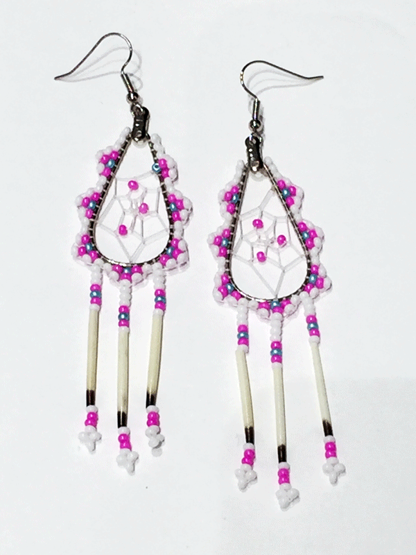 A pair of porcupine quill earrings. The hanging earrings are a tear drop shape hoop with dream catcher style weaving on the inside, with pink beads woven into it. Pink, blue, and white beads are woven along the outside of the hoop and hanging off of the bottom are three strands with white, pink, and blue beads, then a piece of porcupine quill, with more pink and white beads at the end.