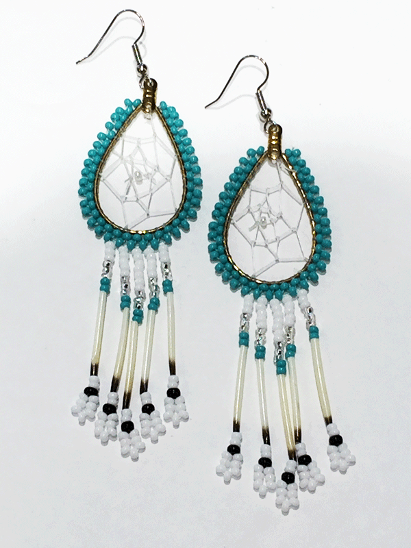 A pair of porcupine quill earrings. The hanging earrings are a tear drop shape hoop with dream catcher style weaving on the inside with a white bead in the center. Turquoise beads are woven along the outside of the hoop and hanging off of the bottom are seven strands with white, silver, and turquoise beads, then a piece of porcupine quill, with more white and black beads at the end.