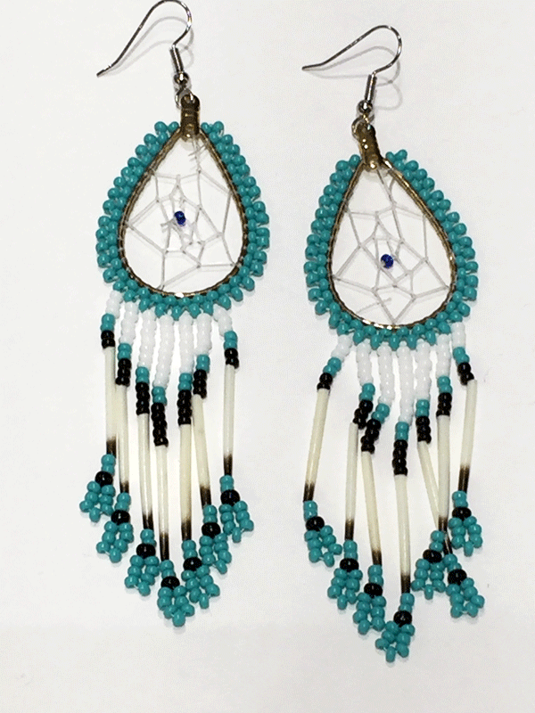 A pair of porcupine quill earrings. The hanging earrings are a tear drop shape hoop with dream catcher style weaving on the inside with a blue bead in the center. Turquoise beads are woven along the outside of the hoop and hanging off of the bottom are seven strands with white, turquoise, and black beads, then a piece of porcupine quill, with more turquoise and black beads at the end.