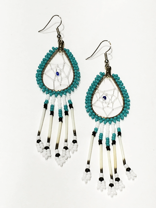 A pair of porcupine quill earrings. The hanging earrings are a tear drop shape hoop with dream catcher style weaving on the inside with a blue bead in the center. Turquoise beads are woven along the outside of the hoop and hanging off of the bottom are five strands with white, turquoise, and black beads, then a piece of porcupine quill, with more white and black beads at the end.