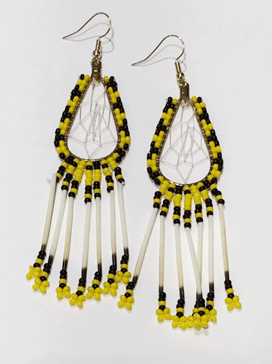 A pair of porcupine quill earrings. The hanging earrings are a tear drop shape hoop with dream catcher style weaving on the inside. Black and yellow beads are woven along the outside of the hoop and hanging off of the bottom are seven strands with yellow and black beads, then a piece of porcupine quill, with more yellow and black beads at the end.