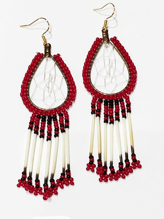 A pair of porcupine quill earrings. The hanging earrings are a tear drop shape hoop with dream catcher style weaving on the inside. Red beads are woven along the outside of the hoop and hanging off of the bottom are seven strands with red and black beads, then a piece of porcupine quill, with more red and black beads at the end.