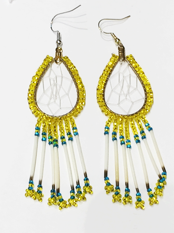 A pair of porcupine quill earrings. The hanging earrings are a tear drop shape hoop with dream catcher style weaving on the inside. Yellow beads are woven along the outside of the hoop and hanging off of the bottom are seven strands with yellow and blue beads, then a piece of porcupine quill, with more yellow and blue beads at the end.