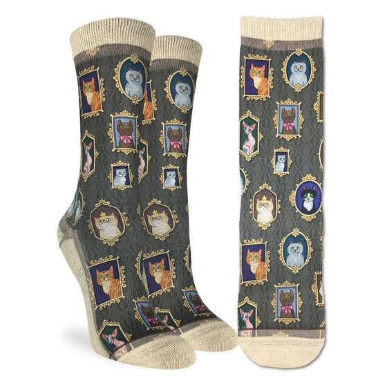 These fun socks feature framed pictures of cats of all shapes and colours hanging on a grey patterned wallpaper. The sole, toe, heel, and rim of the socks are a pale cream colour. The active fit socks sport elastic arch bands to contour to your feet and provide support.