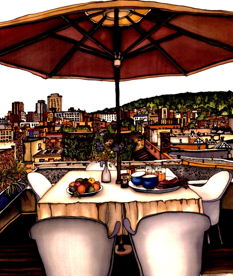 This print shows a rooftop table overlooking Montreal. A bowl of fruit and a tray with four bowls and glasses sit on the table. The table is shaded by a large sun umbrella. The view of the city shows a mix of old architecture and modern skyscrapers. This print recreates the rich watercolours of the original painting.