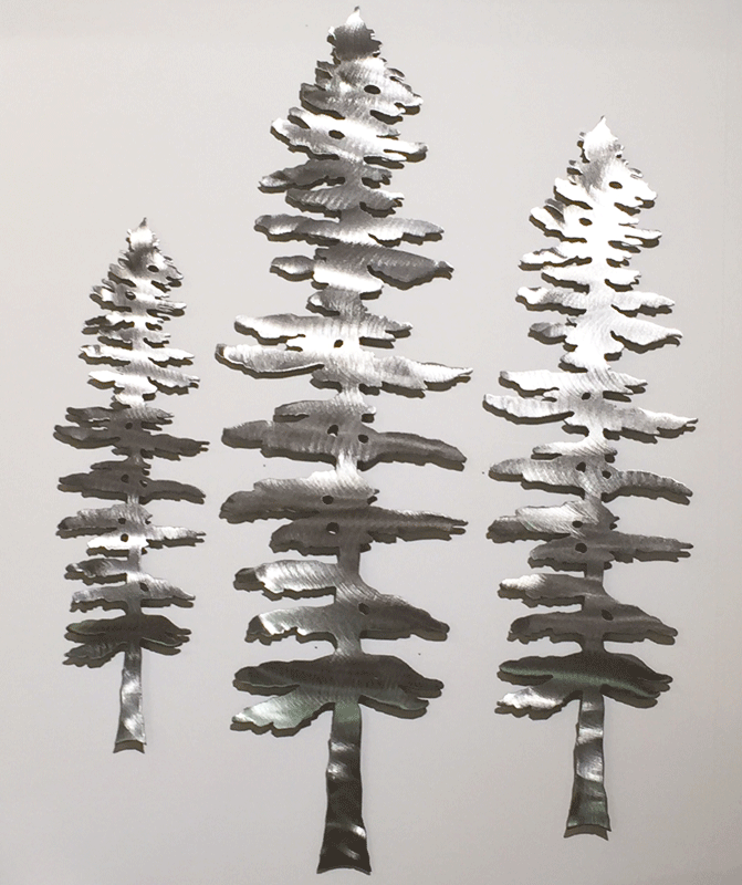 Three brushed metal Sitka pine sculptures. The metal has a bright, sparkling finish.