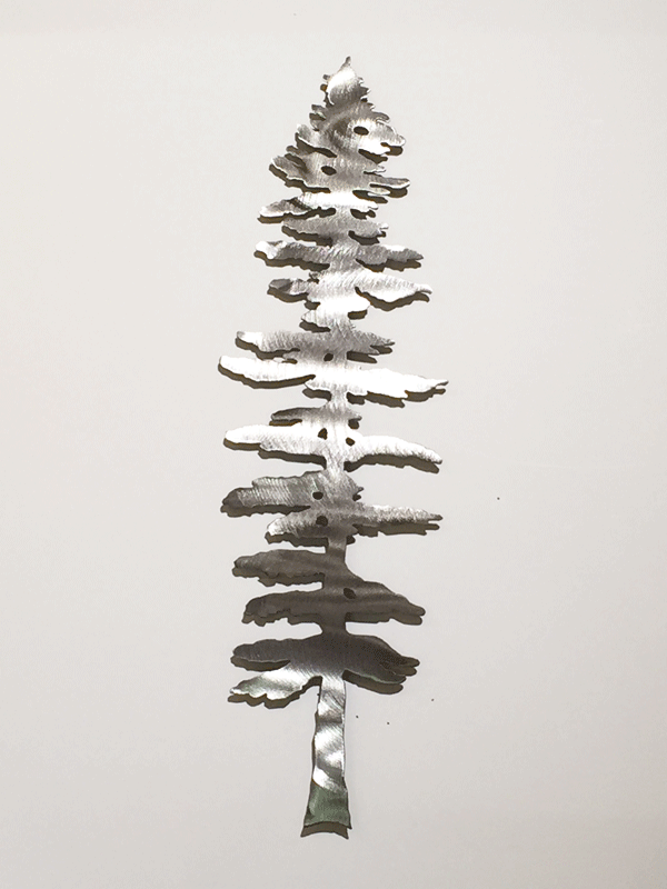 A lone brushed metal Sitka pine sculpture.